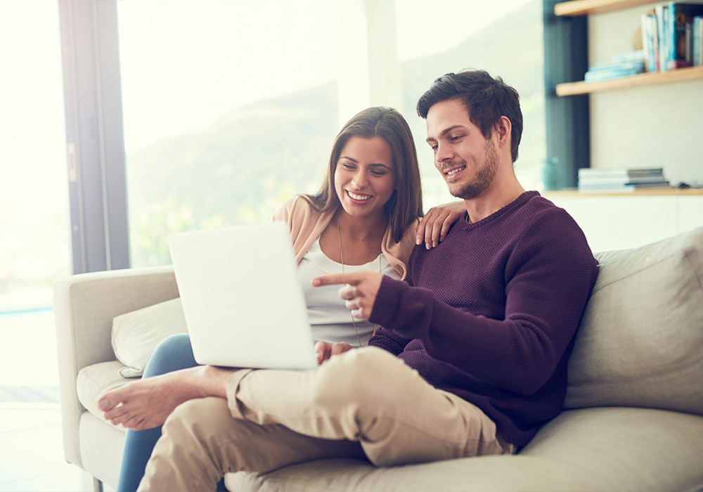 Couple applying for finance on laptop